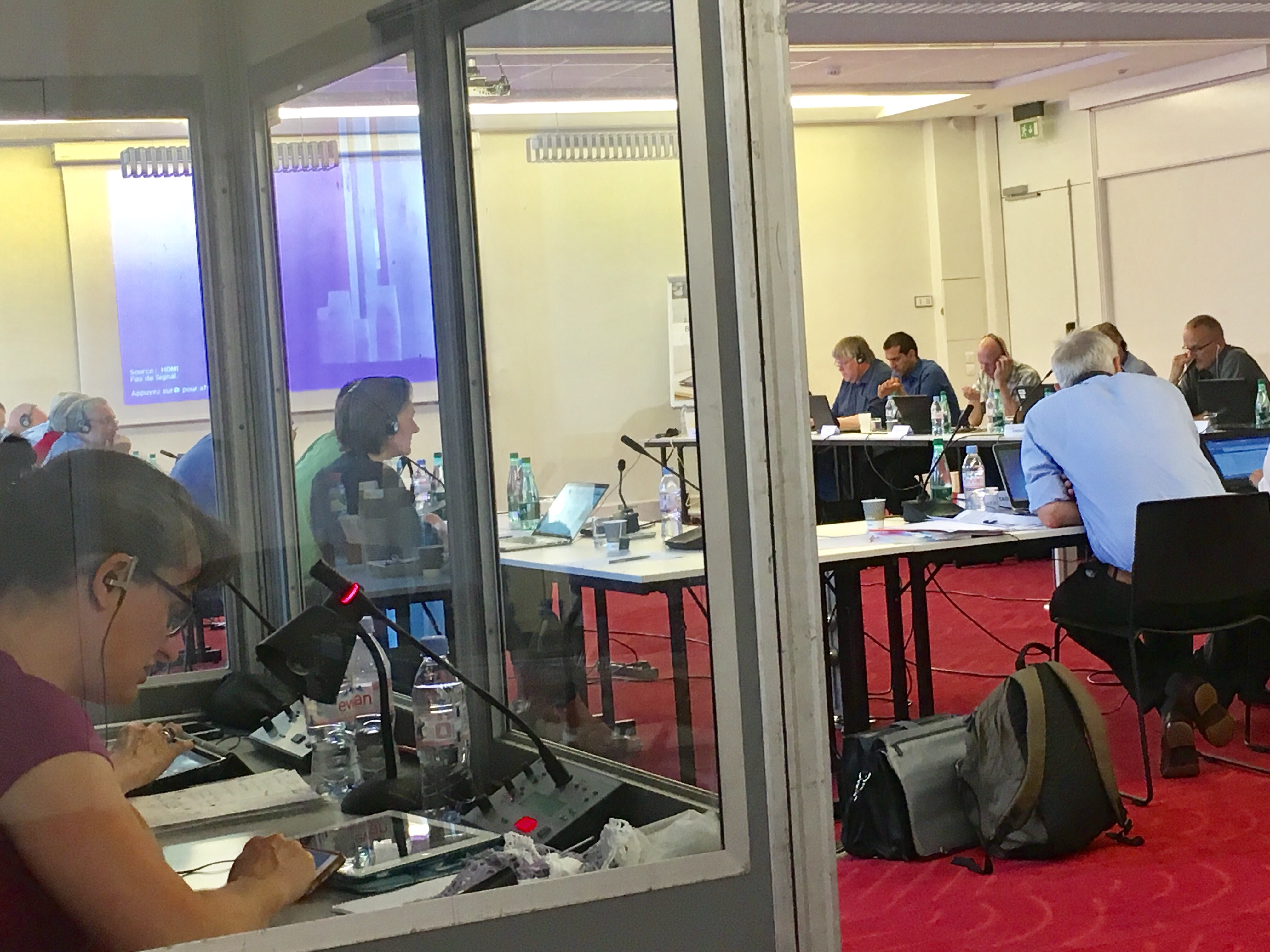 Interpreters at work in their soundproof booths interpreting for delegates at a European Works Council meeting