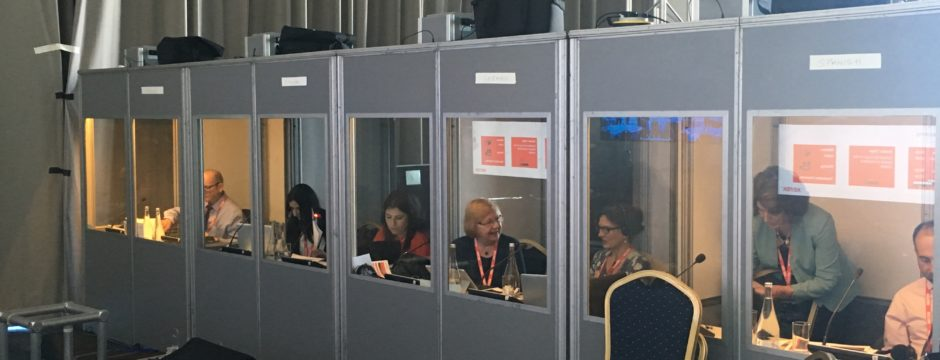 Interpreters at work in soundproof booths backstage at Xerox event in Portugal