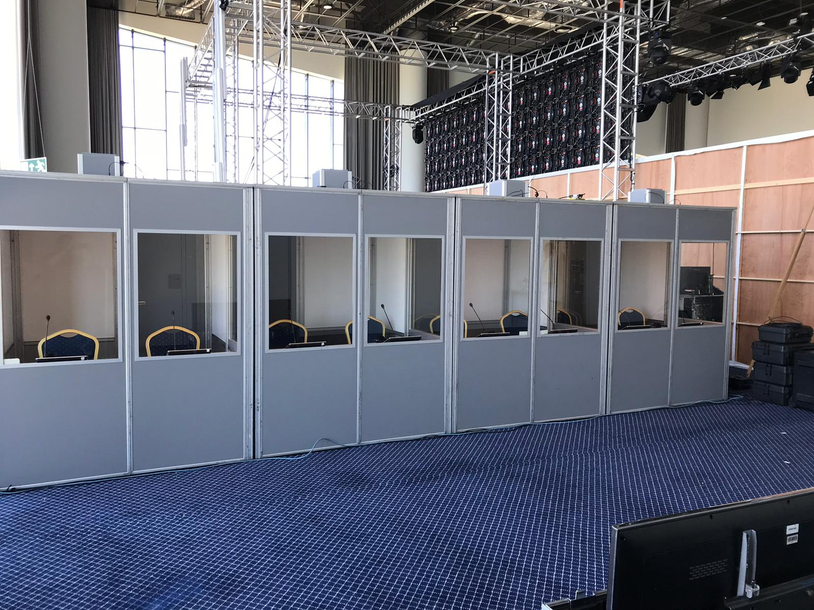 Multiple soundproof interpreter booths set up backstage at Xerox event in Portugal