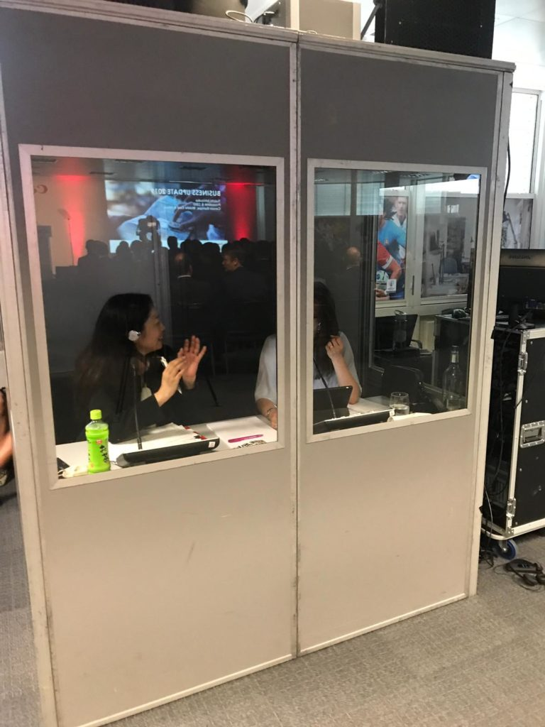 Interpreters in soundproof booth, Canon Shockley Park